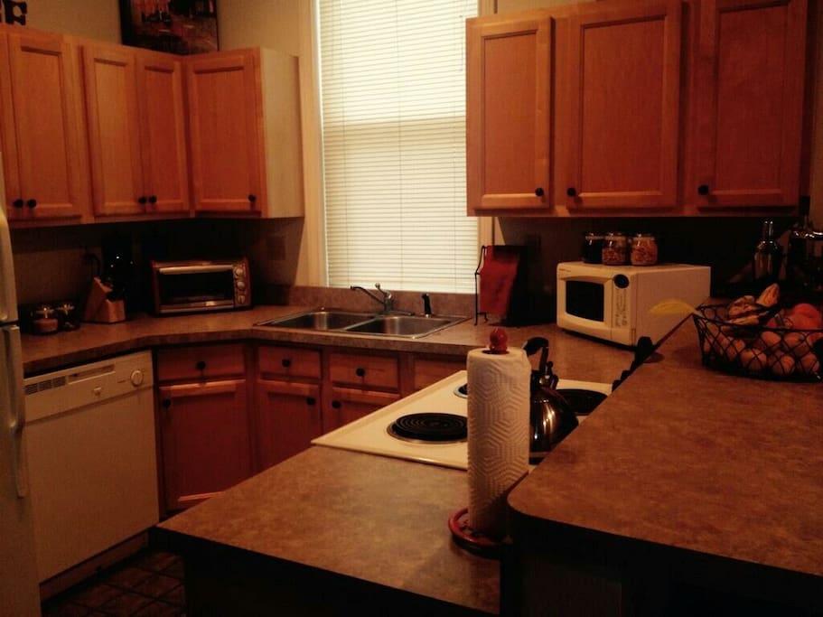 Roomy kitchen with fully stocked fridge