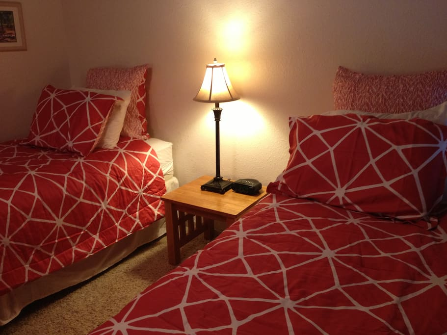 Loft Bedroom includes 2 twin beds, ceiling fan and bath with shower.