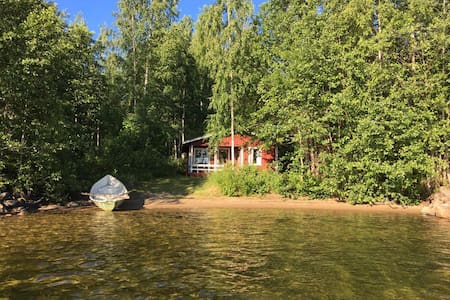 Summer lodge by the lake with sauna