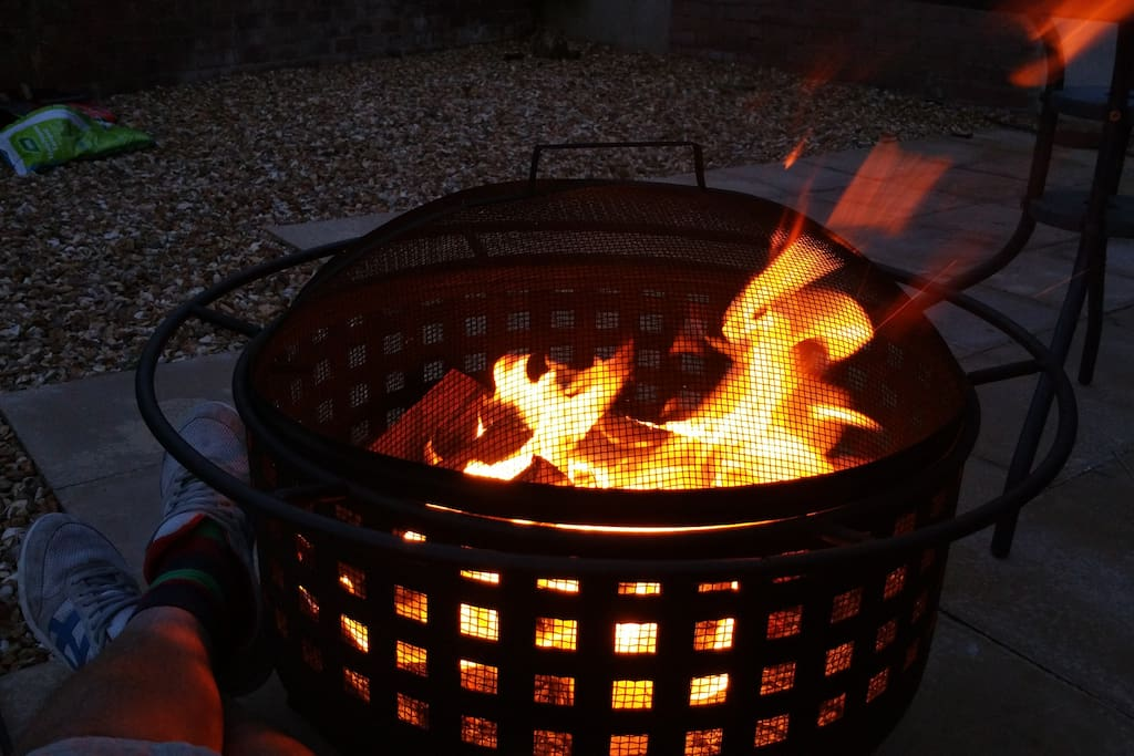 Fire pit in spacious patio area.