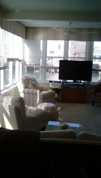 Living room,  spacious and views of back and side.  watch the sunset.