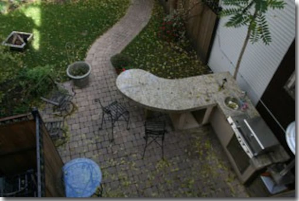 View of backyard patio and grill from the apartment.