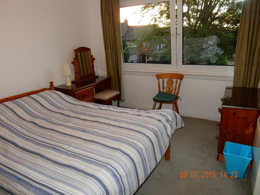 Master bedroom with leafy views towards Fettes College