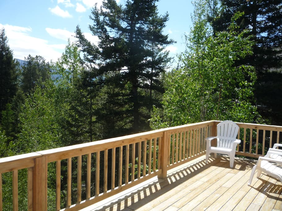 Views of the back deck overlooking Glacier National Park and the surrounding mountains