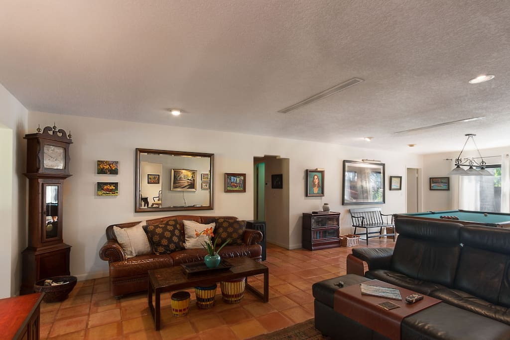 Spacious , comfortable living room beautifully decorated with original oil paintings and master photography.