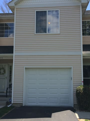 Exterior of unit in this 8-unit townhome community association.   I've since mounted an American flag above the garage door to easily identify my driveway--to park.  Another guest parking spot is available directly across my unit. Street parking too.
