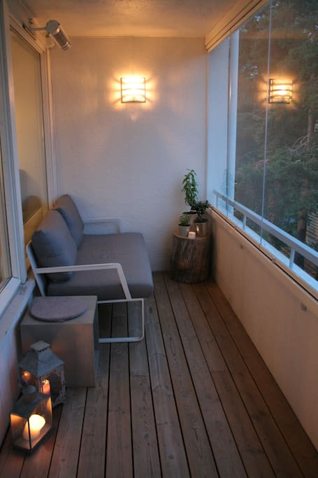 Balcony (12 sqm) at night. Heater and windows to close.