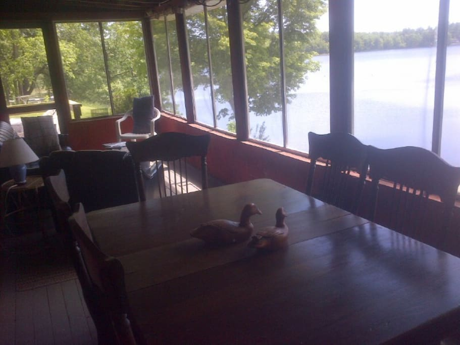 each cottage as a screened in sun porch overlooking lake