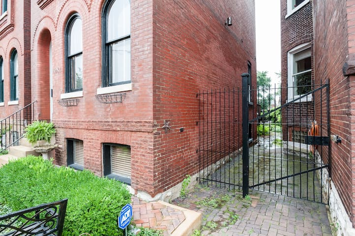 Fenced back yard - come through this gate to your private entrance