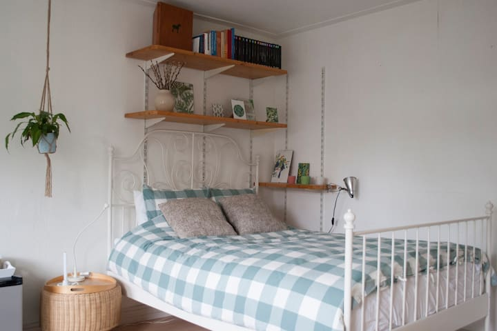Comfortable bed in a bright and spacious bedroom.