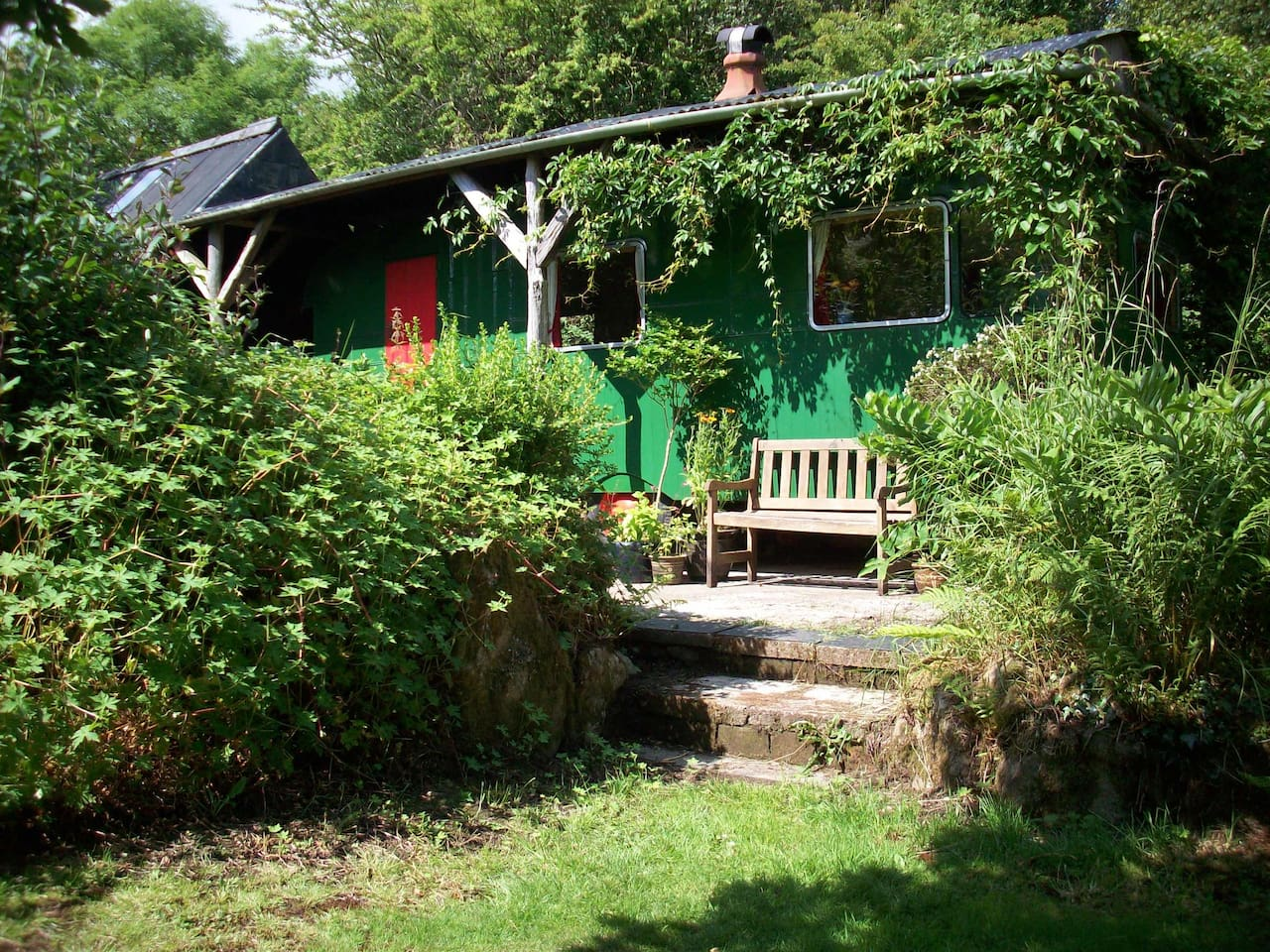 The beautiful vintage caravan at Banc-yr-Eithin complete with private bathroom and own garden, and set within 3 acres of gardens and woodland.