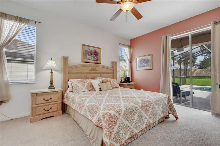 Main Floor Master with Ensuite  Bedroom with King bed The first master suite is located just off the main sitting room. This lovely bedroom offers a very large king sized bed, a flat screen TV as well as views and direct access to the pool deck.