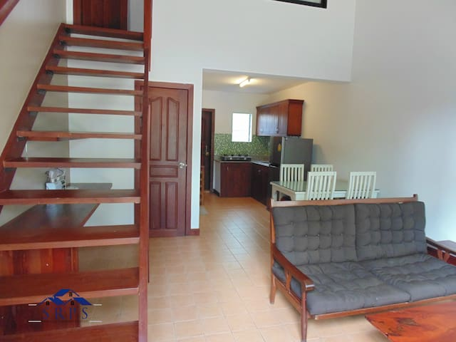 Melody Villa 1 BR home -  living, kitchen & patio.