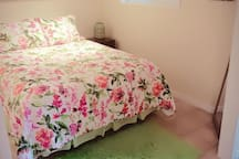 queen bed with summer linens