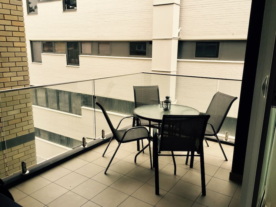 Living Room Balcony with BBQ and Table