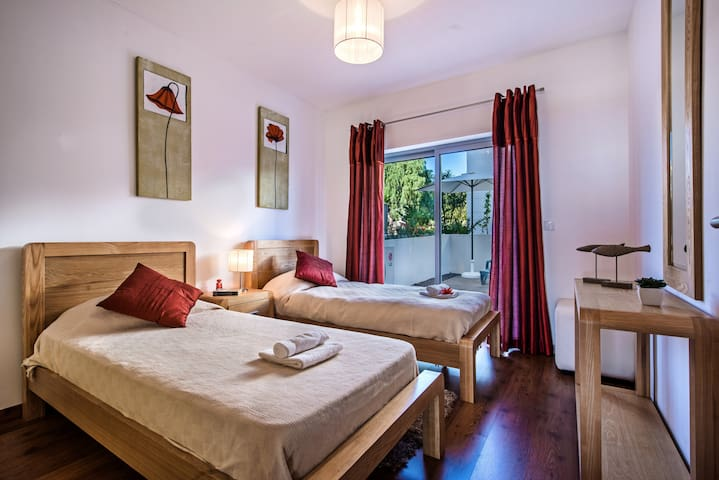 The twin bedroom offers large single beds and air conditioning