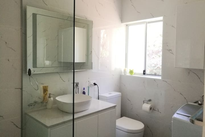 Your have your own private new ensuite bathroom with washing machine, towel, detergent & everything you need