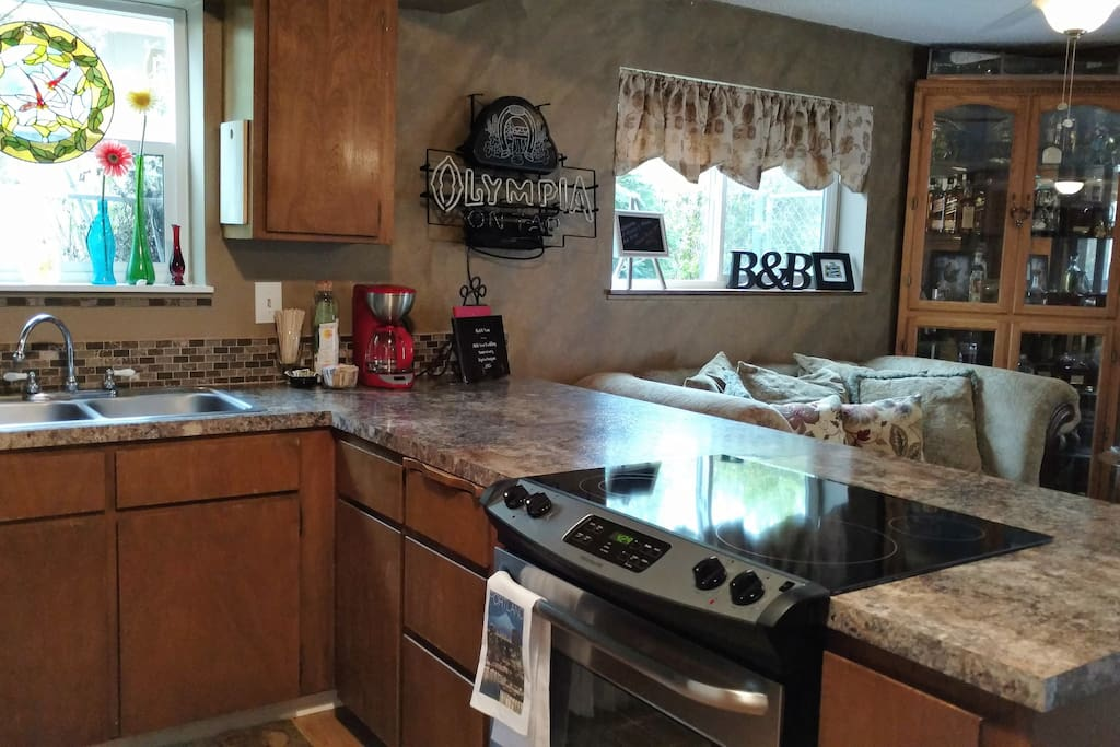 Kitchen, stove, dishwasher, frig , microwave, coffee pot, and double sink, condiments, dishes, pots and pans!