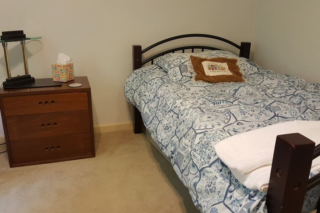 Single bedroom with shared hall bath. Additional mattress can be placed on the floor.