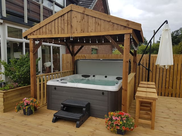 Accessed via the conservatory is our newly installed, totally private and fully decked, hot tub and barbecue area.