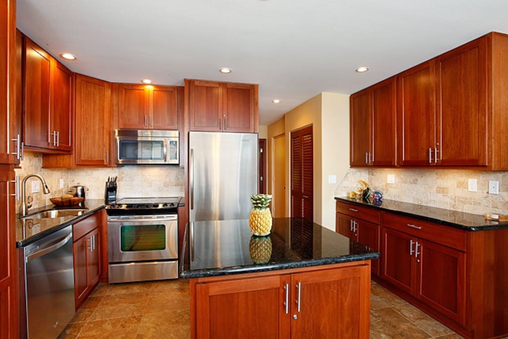When enjoying a relaxing day dining in, you'll find all the comforts of home in a newly remodeled kitchen that includes beautiful granite counter tops, full size stainless steel appliances and a programmable coffee maker.