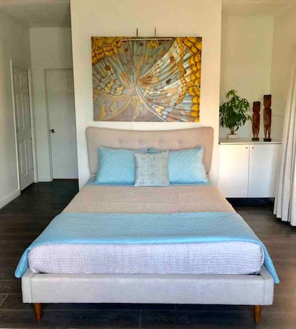 Comfy queen bed. Memory foam mattress with high end bedding in master suite