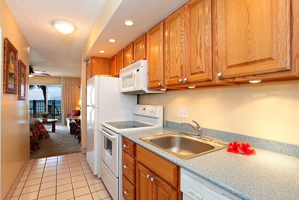 Fully equipped kitchen with full sized appliances, including items like coffee maker, toaster, ample dishes, pots 'n pans...
