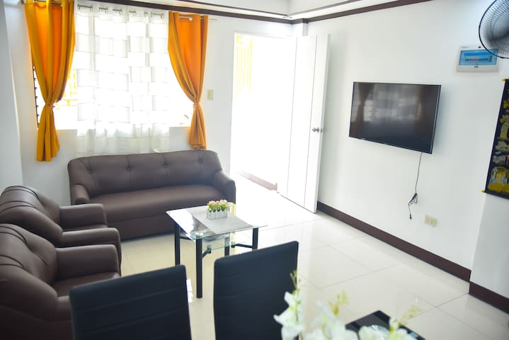The living room where you can enjoy watching 45'' HD TV with cable installed. A place where you can relax.