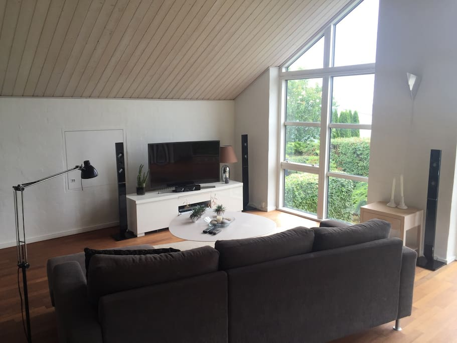 Living room with big screen tv and surround-sound