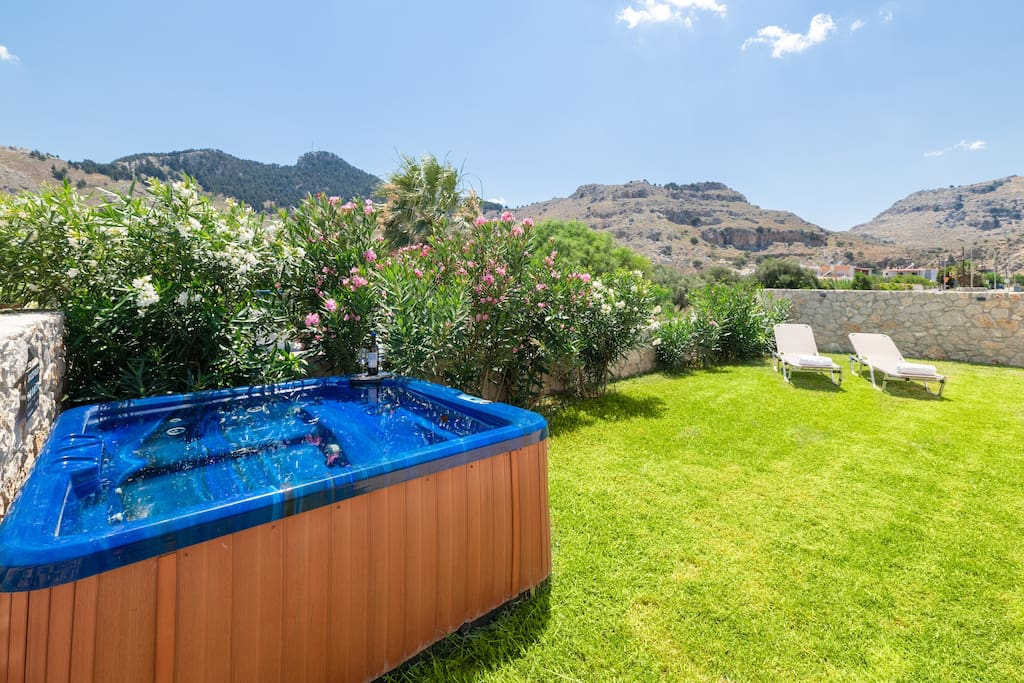Private garden with mountain  views, jacuzzi and sun beds.
