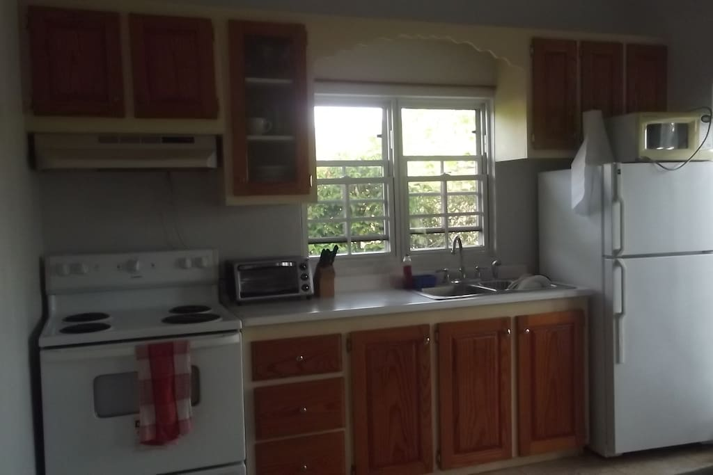 Fully furnished kitchen with basic amenities. Toaster oven, and microwave.