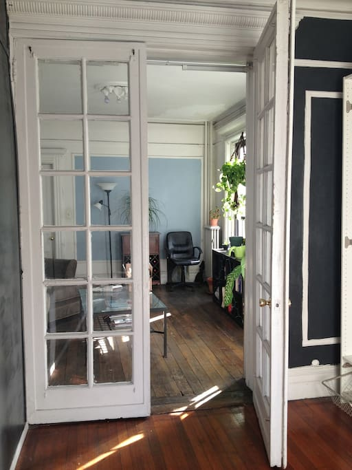 French doors open from the bedroom to the living room
