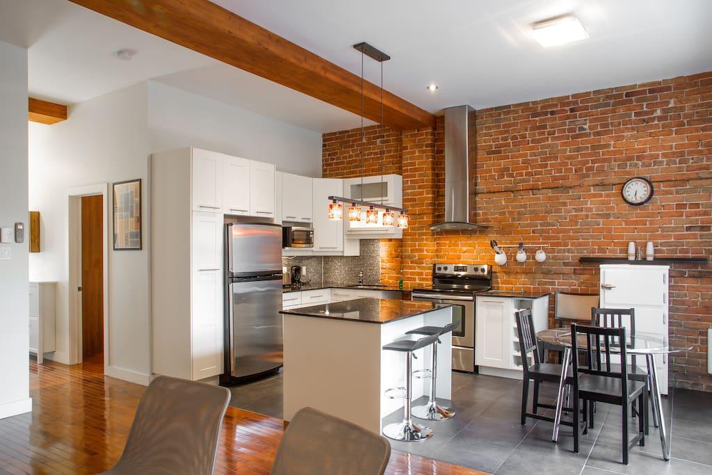 Spacious, open concept kitchen/living area.