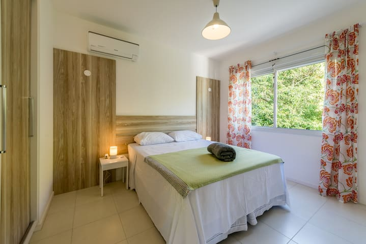 Dormitory with queen size bed, air conditioning and own bathroom
