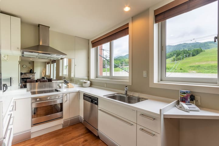 Modern Kitchen with everything you could want overlooking the ski slopes