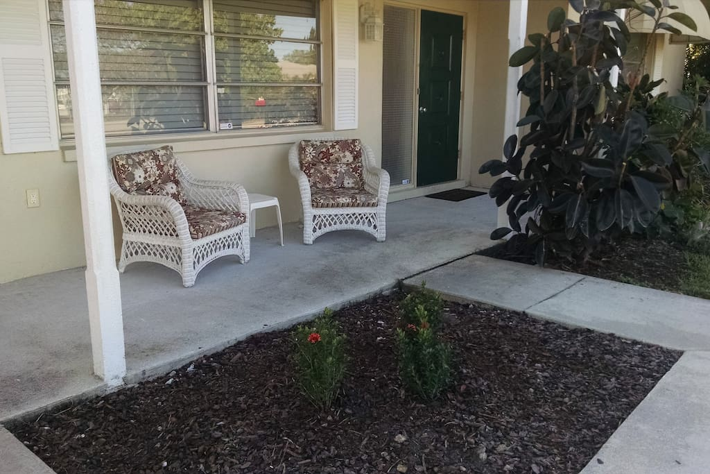 Lovely front porch to enjoy that amazing view of the channel and river.  Yes, we sometimes see dolphins & manatees!