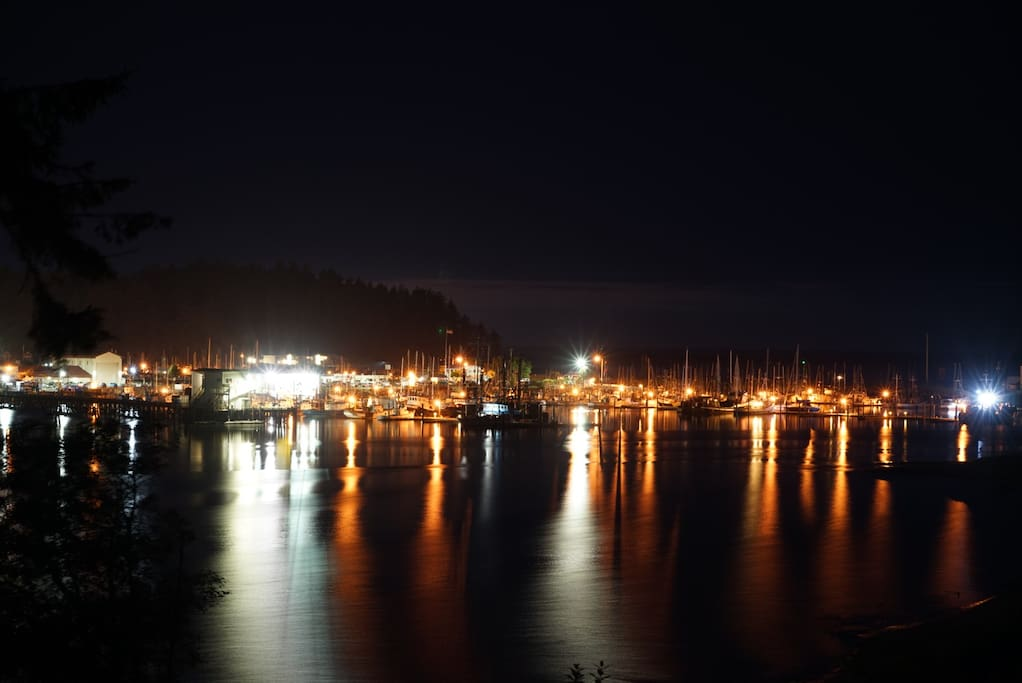 Night time view from living room at high tide