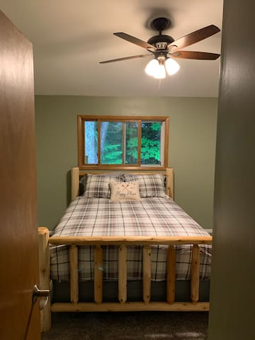 Queen Bedroom 1 has a new log bed frame, bedding and pillows. Bedroom has a dresser. Closet will not be accessible