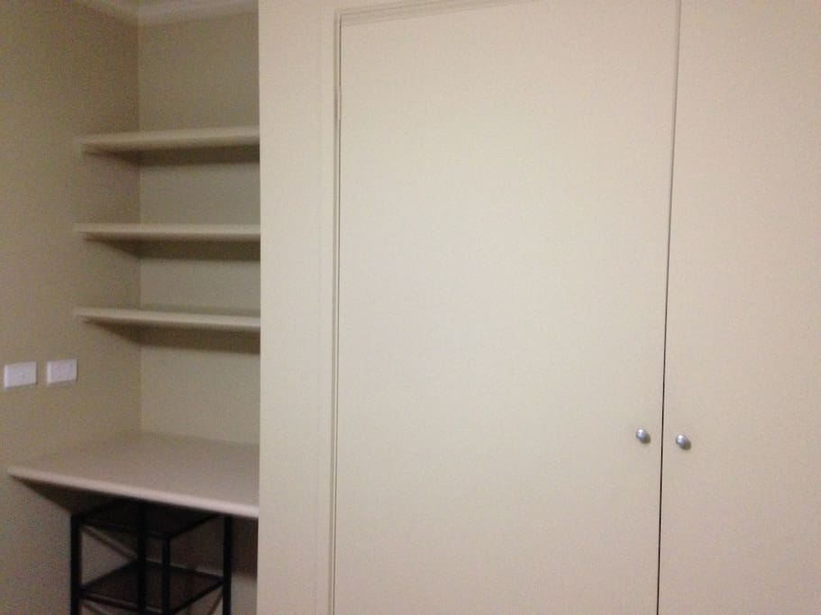 Room has a desk with wardrobe space.