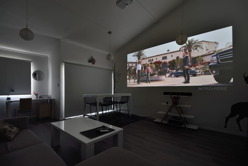 Watching movies on an HD projector.