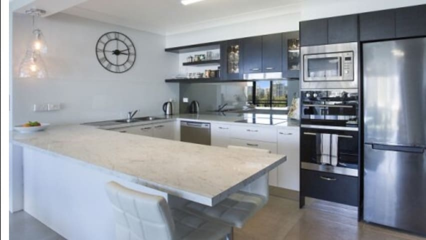 A spacious & beautifully equipped gourmet kitchen is one of the stunning features of this glorious apartment!