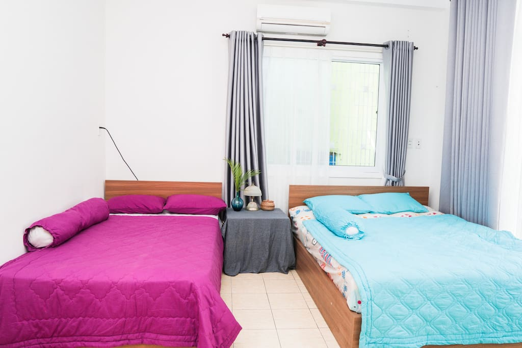There are 1 single bed and 1 queen bed for up to 4 guests with balcony and large window and door.