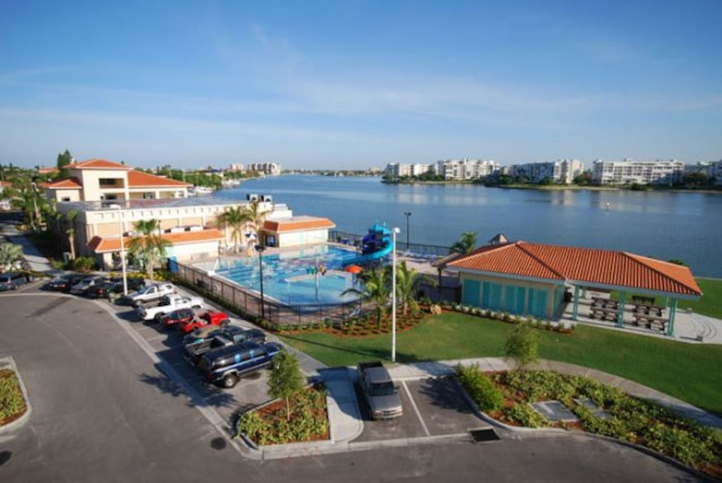 Olympic pool with fun slides on the bay, with waterview gym and beautiful park located outside your window.