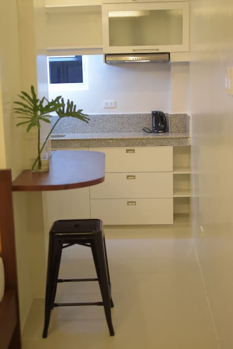 View of clean and modern kitchen with bar counter