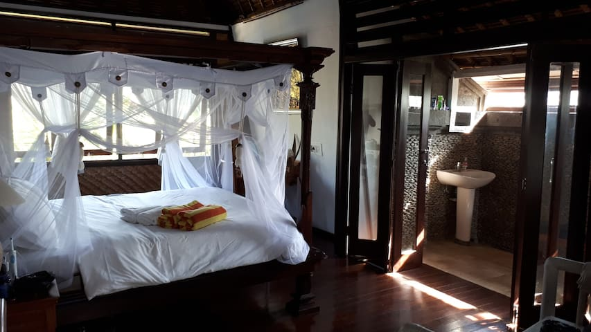 Airy room in Bali thatched villa with pool, Sanur