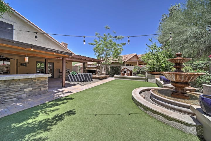 Relax in the resort-style backyard with a covered patio & copper fountain.