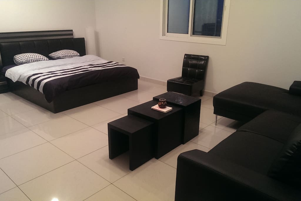 Kingsize bed, sofa and coffee table