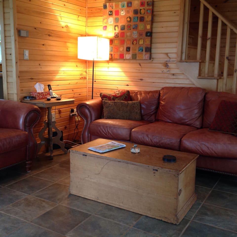 Cozy living room area. Beautiful ceramic floors.