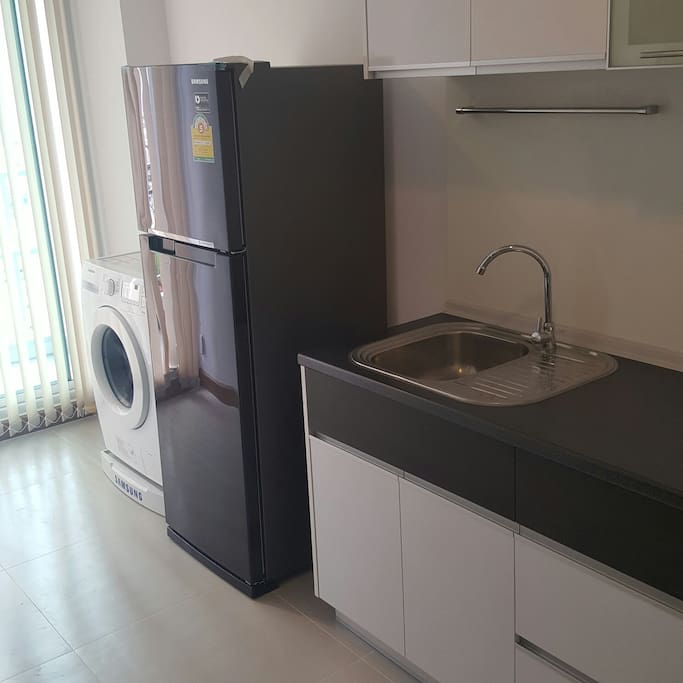 Fully equipped kitchen - Sink, Refridgerator, Microwave, Washing Machine and Cutlery sets