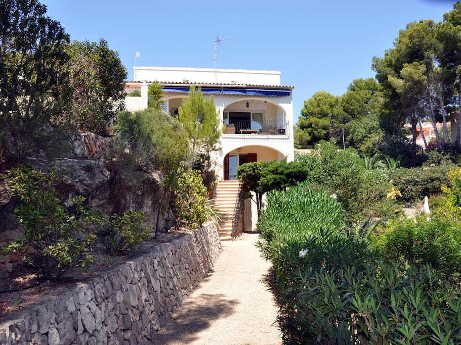 looking up to the front of the villa from garden